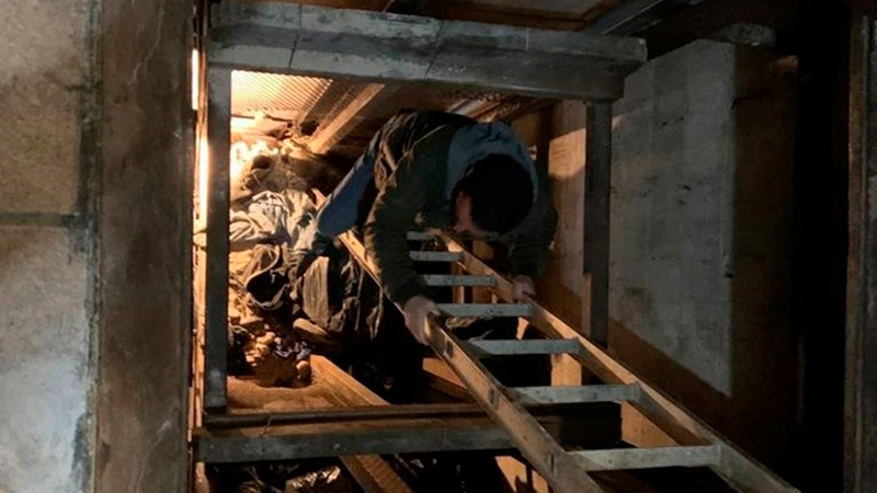 This photo released Tuesday, March 31, 2020, by the San Diego Tunnel Task Force, Department of Homeland Security, shows an entrance in Mexico to a cross-border tunnel running from warehouses in Tijuana to San Diego. (Department of Homeland Security via AP)