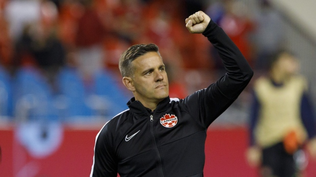 Canada head coach John Herdman raises his fist to the crowd after beating Cuba 6-0 in CONCACAF Nations League play at BMO Field in Toronto, Saturday, Sept. 7, 2019. Herdman had planned to be coaching the Canadian men's soccer team against Trinidad and Tobago on Tuesday in Langford, B.C. Instead he was in his Vancouver-area home, working on a coaching webinar and other duties. THE CANADIAN PRESS/Cole Burston