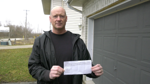 Brockville firefighter Scott Hayward printed up 60 flyers offering to help residents during the COVID-19 pandemic (Nathan Vandermeer/CTV News Ottawa)