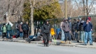 People lineup to get into a homeless shelter Tuesday March 31, 2020 in Montreal.THE CANADIAN PRESS/Ryan Remiorz