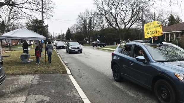 A parade of cars drive down a North York street to celebrate a teen's birthday amid the COVID-19 pandemic. (Scott Lightfoot)