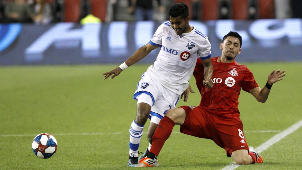 Montreal Impact midfielder Shamit Shome (28) and Toronto FC midfielder Marco Delgado (8) vie for the ball in the second half of the second leg of Canadian Champion soccer action in Toronto, Wednesday, Sept. 25, 2019. Shome is trying to make the most of his time while hunkered at home during the MLS COVID-19 hiatus. THE CANADIAN PRESS/Cole Burston