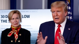 U.S. President Donald Trump speaks about the coronavirus in the James Brady Press Briefing Room of the White House, Tuesday, March 31, 2020, in Washington, as Dr. Deborah Birx, White House coronavirus response coordinator, listens. (AP Photo/Alex Brandon)