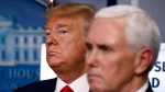 U.S. President Donald Trump and Vice President Mike Pence listen during a briefing about the coronavirus in the James Brady Press Briefing Room of the White House, Tuesday, March 31, 2020, in Washington. (AP / Alex Brandon)