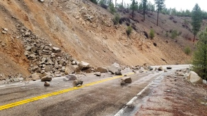 This photo provided by Tyler Beyer shows a rockslide on Highway 21 near Lowman, Idaho, after a magnitude 6.5 earthquake struck Tuesday, March 31, 2020. (Tyler Beyer via AP)