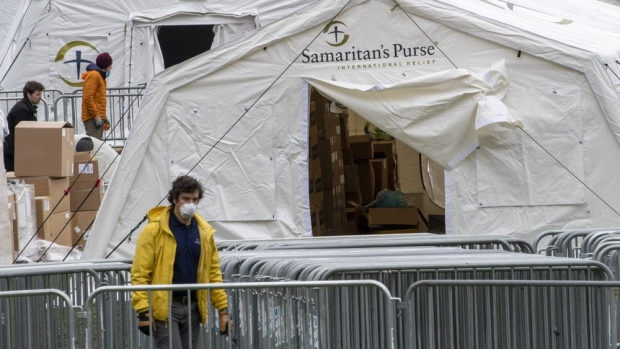 A Samaritan's Purse crew and medical personnel work on preparing to open a 68 bed emergency field hospital specially equipped with a respiratory unit in New York's Central Park, Tuesday, March 31, 2020, in New York. (AP Photo/Mary Altaffer)