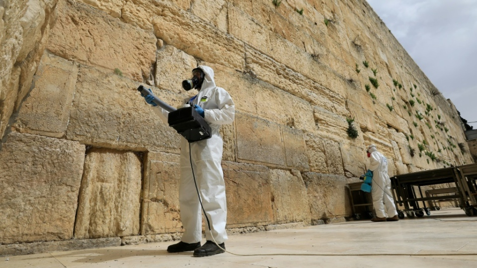 Workers sanitize the Western Wall, the most holy site where Jews can pray against the spread of the coronavirus COVID-19 in Jerusalem. (AFP)