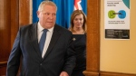 Ontario Premier Doug Ford and Health Minister Christine Elliott exit the daily briefing at Queen's Park in Toronto on Tuesday March 31, 2020. THE CANADIAN PRESS/Frank Gunn