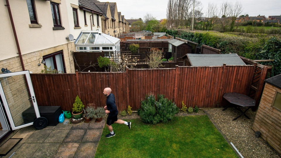 James Campbell runs a marathon in his garden