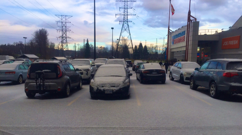 Hail is pictured in a parking lot in North Vancouver. (Photo from Twitter / @meteo_matt)