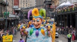 The King's Jester float makes it way down St. Charles Ave. near Canal Street on Mardi Gras Day in New Orleans, Tuesday, Feb. 25, 2020. (David Grunfeld/The Advocate via AP)