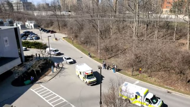 Emergency services workers drive by University Hospital to honour health care workers in London, Ont. on Wednesday, April 1, 2020. (David Comtois / YouTube)