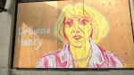 Dr. Bonnie Henry painted by local artist Aby Taylor outside a Vancouver store.