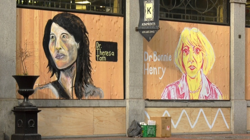Dr. Bonnie Henry and Dr. Theresa Tam depicted by local artists outside a Vancouver art store.