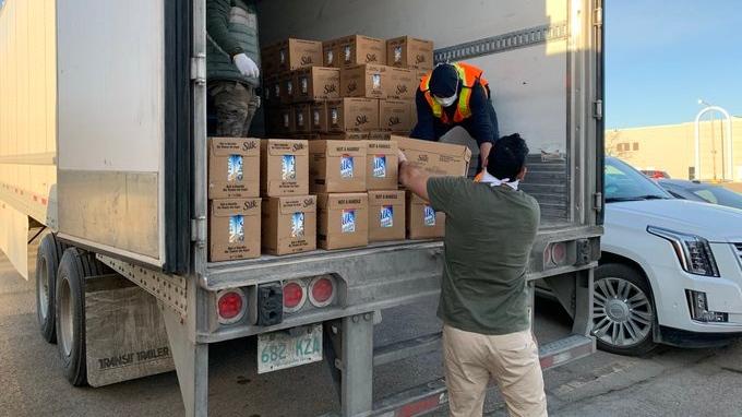 Members of Regina's Sikh community work to donate groceries to those in financial distress due to COVID-19. (Wayne Mantyka / CTV News Regina)