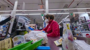 Supermarket staff feel increasingly vulnerable after the death of a cashier in Brescia last month. (AFP)