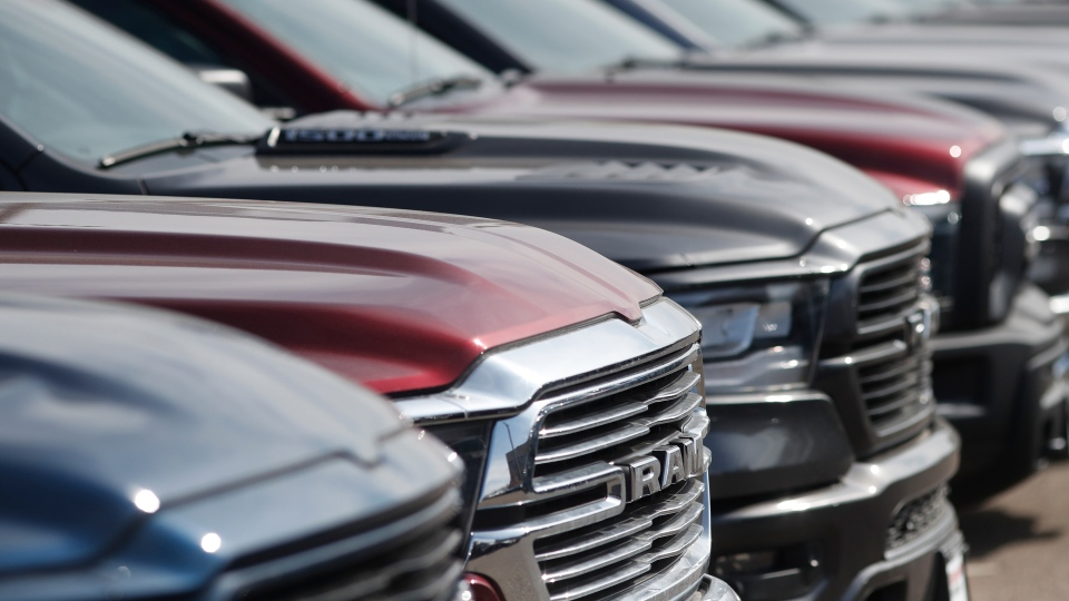 In this Sunday, March 15, 2020, photograph, a long row of unsold 2020 Ram pickup trucks sits at a Dodge dealership in Littleton, Colo. (David Zalubowski/AP/CNN)