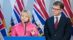 British Columbia Health Minister Adrian Dix looks on as Provincial Health Officer Dr. Bonnie Henry addresses the media during a news conference at the BC Centre of Disease Control in Vancouver B.C, Tuesday, January 28, 2020. (Jonathan Hayward / THE CANADIAN PRESS)