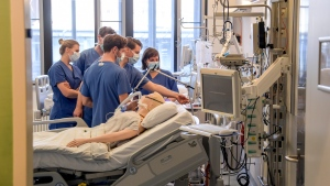 In this Tuesday, March 25, 2020, photo, hospital doctors get instructions on a ventilator at the University Hospital Eppendorf in Hamburg Germany. (Axel Heimken/Pool Photo via AP)
