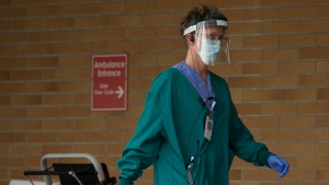 A health care worker is seen outside the Lions Gate Hospital in North Vancouver, B.C. Tuesday, March 31, 2020. THE CANADIAN PRESS/Jonathan Hayward