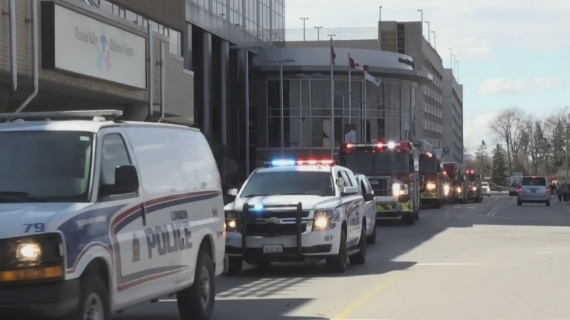 Police cruisers, ambulances and fire trucks made their way by hospitals in London, Ont. on Wednesday, April 1, 2020 in a salute to health care workers. (Jim Knight / CTV London)