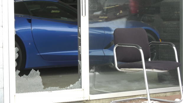 Vehicle driven out of dealership showroom during break-in