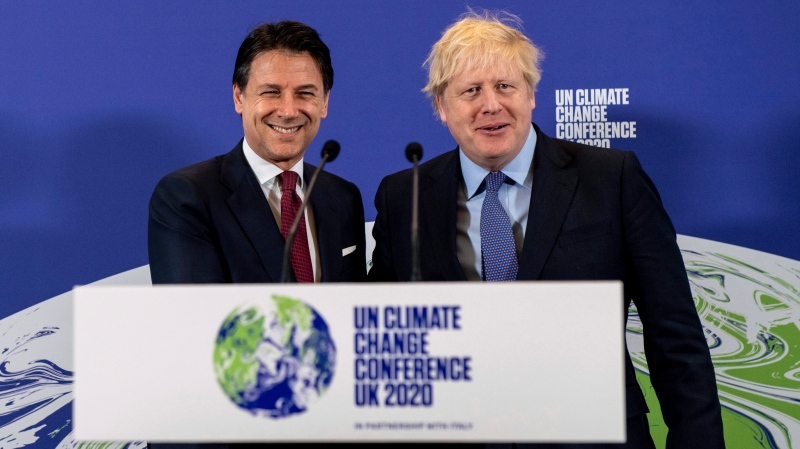 Britain's Prime Minister Boris Johnson, right, and Italy's Prime Minister Giuseppe Conte attend the launch of the upcoming UK-hosted COP26 UN Climate Summit in London, Tuesday Feb. 4, 2020, that was supposed to take place in autumn 2020 in Glasgow, Scotland. (Chris J Ratcliffe/Pool via AP)