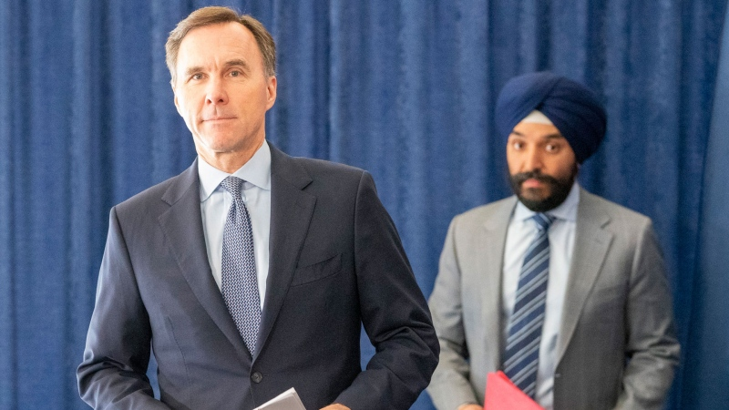 Federal Finance Minister Bill Morneau (left) and Minister of Innovation, Science and Industry Navdeep Bains arrive for a news conference in Toronto on Wednesday April 1, 2020. THE CANADIAN PRESS/Frank Gunn