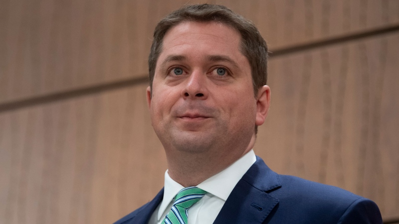 Leader of the Opposition Andrew Scheer listens to a question during a news conference on the COVID-19 virus in Ottawa, Tuesday March 24, 2020. THE CANADIAN PRESS/Adrian Wyld