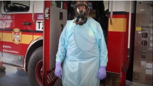 Ottawa Fire says firefighters will wear the Self Contained Breathing Apparatus while responding to call calls with patient contact. (Photo courtesy: YouTube/Ottawa Fire Services)