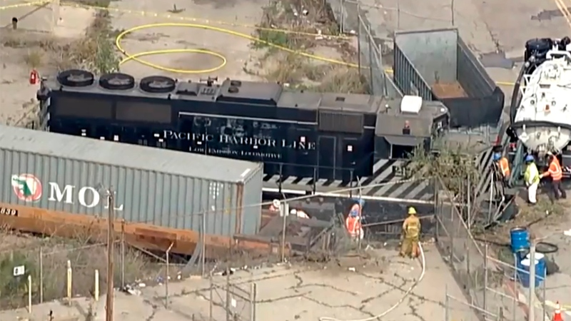 This aerial image taken from video provided by KABC-TV shows a Pacific Harbor Line train that derailed Tuesday, March 31, 2020, at the Port of Los Angeles after running through the end of the track and crashing through barriers, finally coming to rest about 250 yards from the docked U.S. Navy Hospital Ship Mercy.  (KABC-TV via AP)