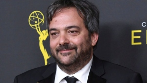 """This Sept. 14, 2019 file photo shows Adam Schlesinger, winner of the awards for outstanding original music and lyrics for """"Crazy Ex Girlfriend,"""" in the press room at the Creative Arts Emmy Awards in Los Angeles. Schlesinger, an Emmy and Grammy winning musician and songwriter known for his band Fountains of Wayne and his songwriting on the TV show """"Crazy Ex-Girlfriend,"""" has died from coronavirus at age 51. (Photo by Richard Shotwell/Invision/AP, File)"""