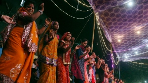 In this Thursday, Oct. 11, 2018 file photo, Hindus dance to celebrate the nine-day Navaratri festival in Karachi, Pakistan. It begins with what for many is considered the Hindu New Year and will culminate with the festival of Ramanavami. This year, the festival is very different, due to COVID-19 precautions. (AP Photo/Shakil Adil)