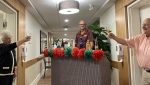Seniors care facility staff come up with safe, imaginative ways to keep residents socially active. Kevin Fleming reports