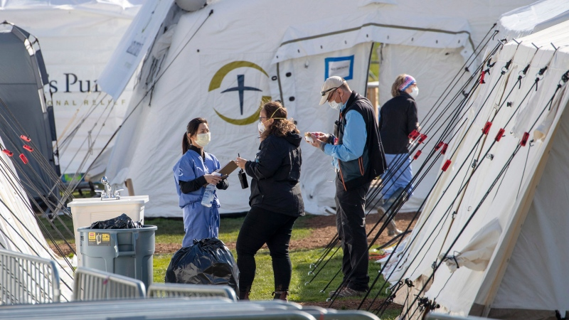 Medical personnel work at the Samaritan's Purse field hospital in New York's Central Park, Wednesday, April 1, 2020. The new coronavirus causes mild or moderate symptoms for most people, but for some, especially older adults and people with existing health problems, it can cause more severe illness or death. (AP / Mary Altaffer)