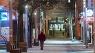 A man strolls through an almost empty Chinatown in Montreal, Wednesday, April 1, 2020, as COVID-19 cases rise in Canada and around the world. THE CANADIAN PRESS/Graham Hughes