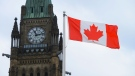 A Canadian flag flies by Parliament Hill in Ottawa on Friday, March 13, 2020. THE CANADIAN PRESS/Sean Kilpatrick