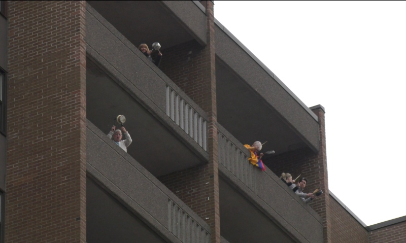 Residents of a west Ottawa building make noise for essential workers during the COVID-19 pandemic, April 1, 2020.