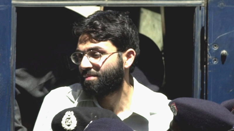 FILE - In this March 29, 2002, file photo, Ahmed Omar Saeed Sheikh, the alleged mastermind behind Wall Street Journal reporter Daniel Pearl's abduction, arrives at a court in Karachi, Pakistan. (AP Photo/Zia Mazhar, file)