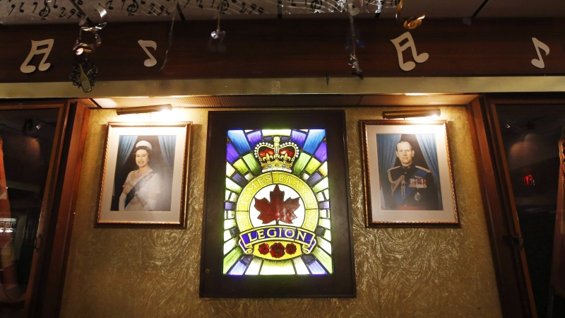 Photos of royalty hang on the walls at The Royal Canadian Legion, St James Branch No. 4 in Winnipeg, Manitoba Thursday, November 8, 2018. THE CANADIAN PRESS/John Woods