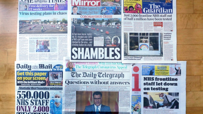 A view of the front pages of Britain's newspapers showing their coverage of the coronavirus, in London, Thursday, April 2, 2020. (AP Photo/Kirsty Wigglesworth)