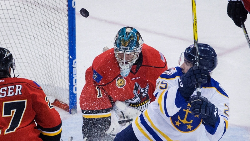 FILE - In this Jan. 4, 2017, file photo, a shot by Norfolk Admirals' Alex Pompeo (25), right, deflects up into the air off Adirondack Thunder's goalie J.P. Anderson (1) during the first period of an ECHL hockey game in Norfolk, Va. The ECHL season was canceled because of the coronavirus pandemic. (L. Todd Spencer/The Virginian-Pilot via AP, File)