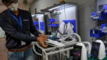 Originally created by a robot scientist and a neurosurgeon to help India's poor, the AgVa ventilator is now offering hope in the country's coronavirus fight. (AFP)