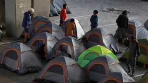 Homeless people in Cape Town South Africa are housed in tents at a shelter Wednesday April 1, 2020 as the country continued the nationwide 21 days lockdown in an effort to control the spread of the coronavirus. (AP Photo/Nardus Engelbrecht)