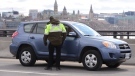 Quebec police officers randomly stop traffic entering Quebec from Ottawa on Wednesday, April 1, 2020, during the COVID-19 pandemic. (Sean Kilpatrick/THE CANADIAN PRESS)