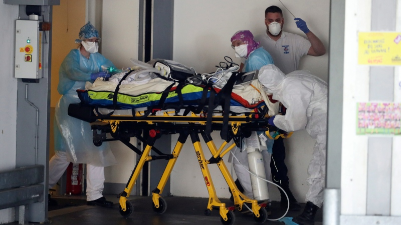 A patient infected with the Covid-19 virus is admitted in an hospital Wednesday April 1, 2020 in Rennes, western France. (AP Photo/David Vincent)