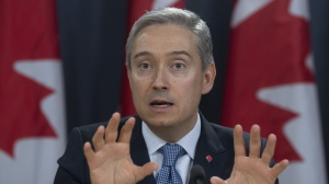 Foreign Affairs Minister Francois-Philippe Champagne responds to a question during a news conference in Ottawa on March 9, 2020. THE CANADIAN PRESS/Adrian Wyld