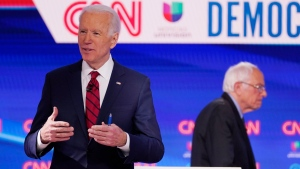 In this March 15, 2020, file photo Sen. Bernie Sanders, I-Vt., right, and former Vice President Joe Biden, left, return to the stage after a commercial break in a Democratic presidential primary debate at CNN Studios in Washington. White House contenders aren't typically bashful about asking for money. (AP Photo/Evan Vucci, File)