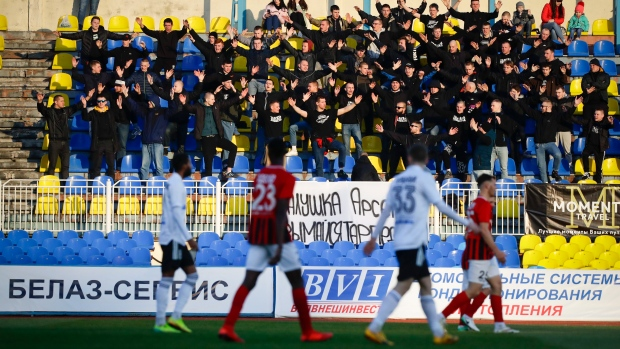 In this file photo taken on Friday, March 27, 2020, fans of Torpedo Zhodino cheer during the Belarus Championship soccer match between Torpedo-BelAZ Zhodino and Belshina Bobruisk in the town of Zhodino, Belarus. (AP Photo/Sergei Grits, File)