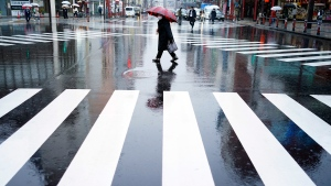 A woman walks in the empty Asakusa district Wednesday, April 1, 2020, in Tokyo. (AP Photo/Eugene Hoshiko)